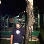 Man_with_gator_hanging