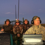 Steve_and_men_on_airboat_dusk