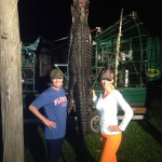 two_women_and_a_hanging_gator_at_night